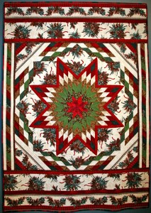 """Pine Cones for Winter Solstice: Greenery to Honor the Rebirth of the Sun"" The curved beauty of the Eastern White Pine Cone is featured in this border print fabric carefully cut to frame the star. 62"" x 72"""