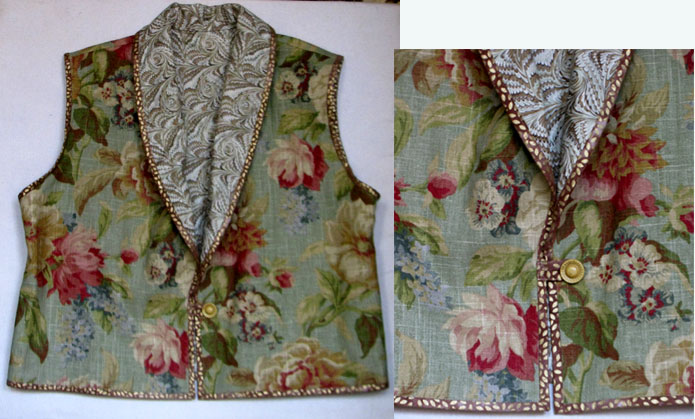 Shawl collar vest of floral fabric with vintage button and gold leaf binding.