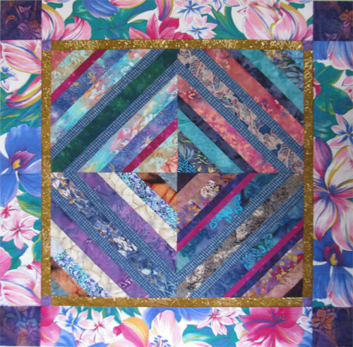 The center section was begun in the late 1990s for a string piecing class I taught at Quilt Your Heart Out.. when I found this bold floral in my stash, I finished it in time for the exhibit.