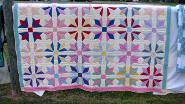 We bring favorite quilts to our annual Airing of the Quilts. Some are unique examples of vintage quilts like this one that hung in 2014.