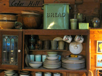"This green enamel bread box probable dates to the time period when ""Jadite"" items were seen in kitchens across the country--perhaps even with wood trim in the kitchen painted in this same green. This bread box has been a central feature of my kitchens since the mid-1970s when I found it at a Kansas City flea market."