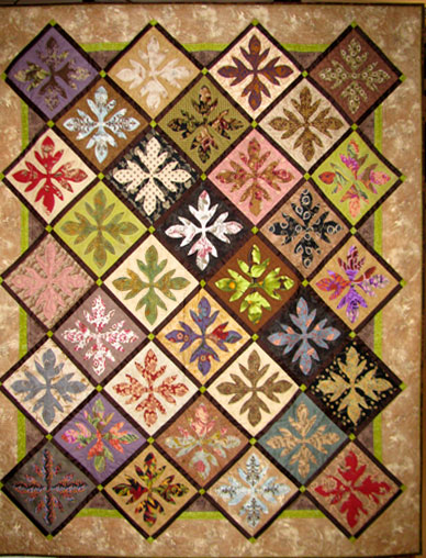 "In 2000 I began these Tobacco Leaf hand appliqued blocks as my favored ""take-along"" project. Called ""Fifteen Years of Applique"" it measures 60"" x 75"". Arranging blocks of differing values gives it visual interest. Note how the lights jump out and the darks seems to recede."