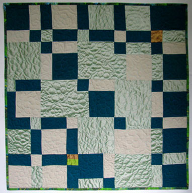 "Downward Mobility, 32"" x 32"", is my all-silk experiment completed in 2015. Most of the silk is recycled from thrift shop garments. I did the free motion quilting on my 1971 Bernina 830."