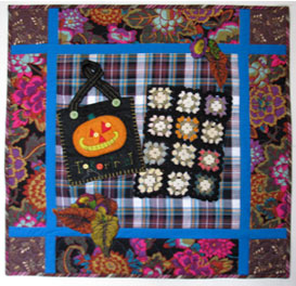 "My mother's Halloween costumes designed for her four kids were often creative, and sometimes spectacular. Fond memories of her are but one of the reasons I like working with fall colors and pumpkin themes. These thrift shop finds called to me and now seem to have always belonged together. Pumpkin Treat, 2014, 29"" x 28"""