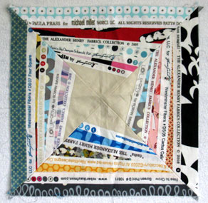 This is the block created and rejected by Jacquie Gering. Therese Ramsey bought it at Jacquie's studio sale. I replace the plain muslin center with a small black square surrounded by a vibrant red.