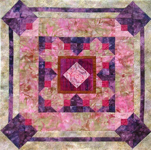"The Split Nine Patch block with its strong diagonal of light and dark allows you to use the variety of settings usually associated with the log cabin block. I added a unusual border treatment here to give a three dimensional feel. 36"" x 36"""