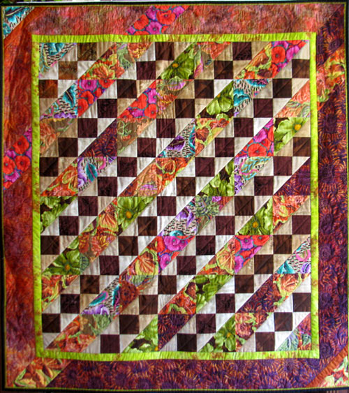 "I've called this block Three Triangles and a Square because I cannot find another name. Can you? Quilt title is Poppies and Sunflowers and measures 46"" x 45""."